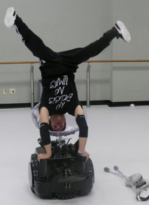 "Luca ""Lazylegz"" Patuelli dpes handstand on the Rolling Dance Chair."