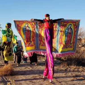Stilt-walkers outside Tornillo detention center